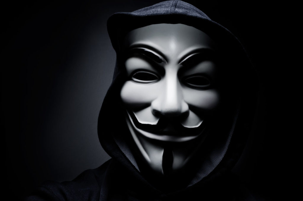 stock-photo-paris-france-january-man-wearing-vendetta-mask-this-mask-is-a-well-known-symbol-for-244924321-1